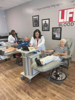 Lifeline Dyersburg board members Bill Van Sant and Patsy Harris donated blood on Tuesday just after the ribbon cutting.