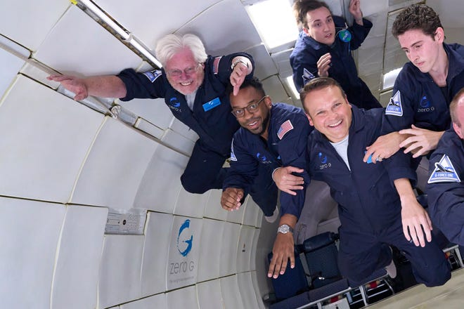 Gary Nosacek, top left, floats inside the cabin of a plane with other tourists while on a flight with Zero-G above Las Vegas on July 11, 2021.
