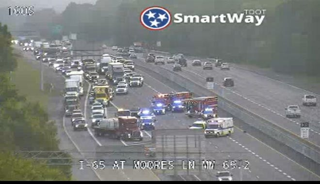 All lanes were temporarily closed on I-65 southbound at Moores Lane after an early Wednesday morning wreck.