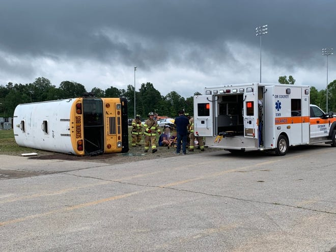 First responders and school staff go through a mock bus crash scenario at the Dickson County Fairgrounds on Tuesday.