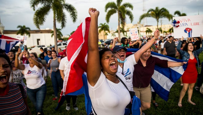 """Rosa Maso, who is originally from Cuba chants while taking part in a march demanding freedom for the Cuban people on Tuesday, July 13, 2021 in downtown Fort Myers . The event in Fort Myers was called the Walk for Cuba. About a 1,000 people attended the event. She said """"My people are dying down there."""" She said one family member has died and one is missing."""