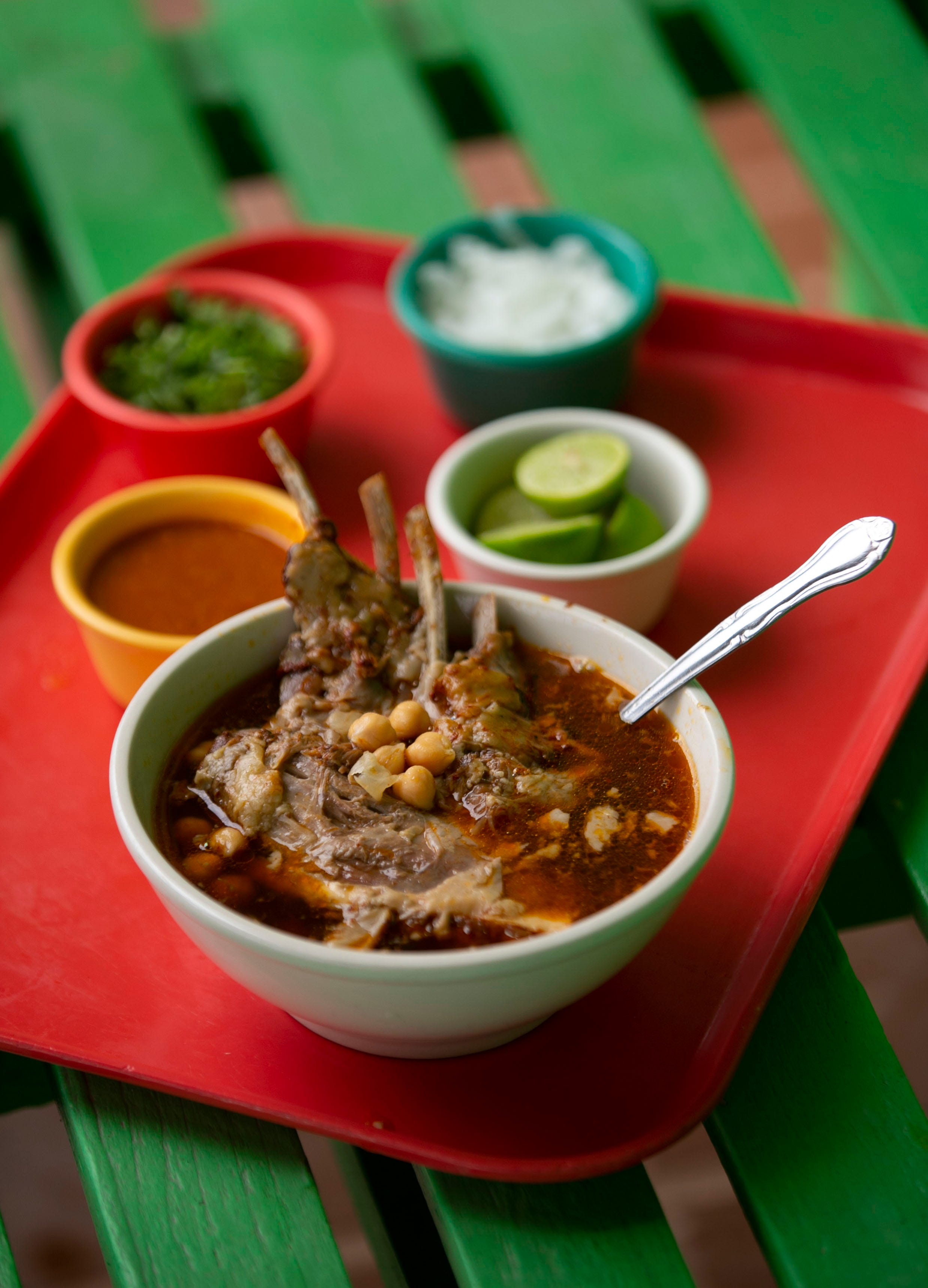Birria ribs in broth at Hola Cabrito restaurant in Phoenix on July 14, 2021. The restaurant specializes in birria de chivo, goat meat with a secret marinade that's stewed for hours.
