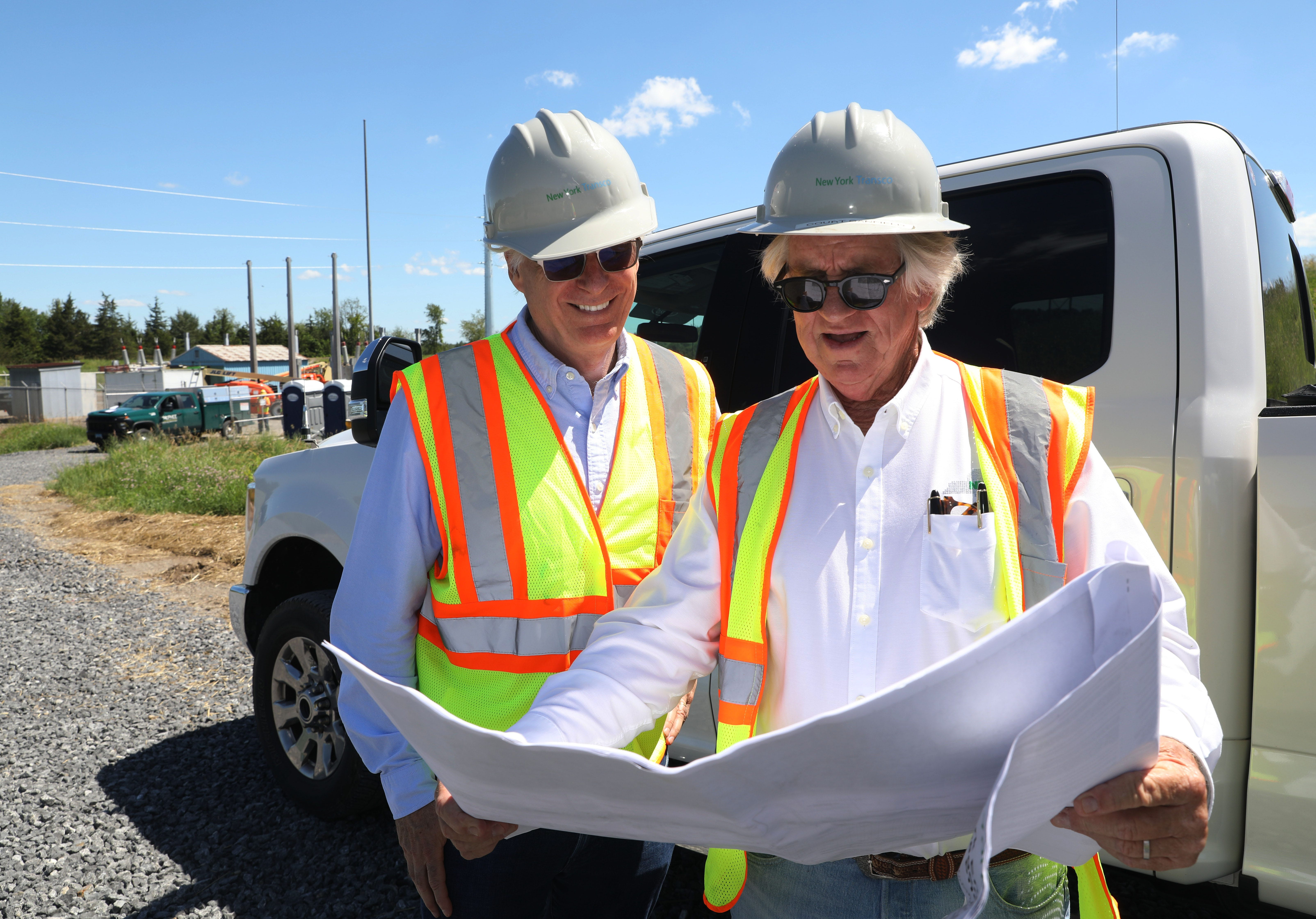 From left, New York Energy Solution Construction Director Court Canfield and New York Transco President Vic Mullin check in on a transmission line upgrade in progress near the Churchtown switching station in Claverack on June 24, 2021.