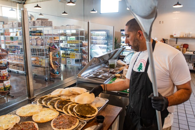 Chafic Dada prepares Manakeesh and other traditional Mediterranean breakfast items at PK Deli & Bakery.