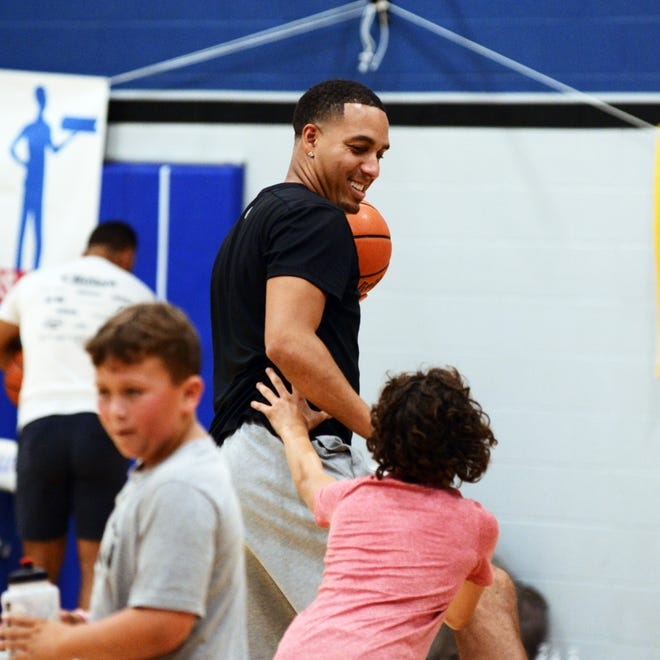 Former Zanesville High School standout Kevin Martin, who played for five teams in the NBA, horses around with nephew Kelby during his annual basketball camp at Zanesville Middle School. Martin said on Tuesday that this will be the last year for the camp.