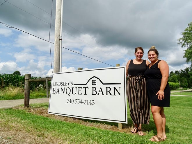 Sisters and business co-owners Nicole Lindsley (left) and Kailey Lindsley stand outside of their family's event hall Lindsley's Banquet Barn. The event space is in a barn at 4060 New Riley Road near their home.