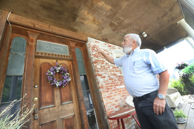 Steve Stewart talks about the window above the door to the Nelson T. Gant House in Zanesville. The lettering has survived since Gant owned the house prior to his death in 1905.