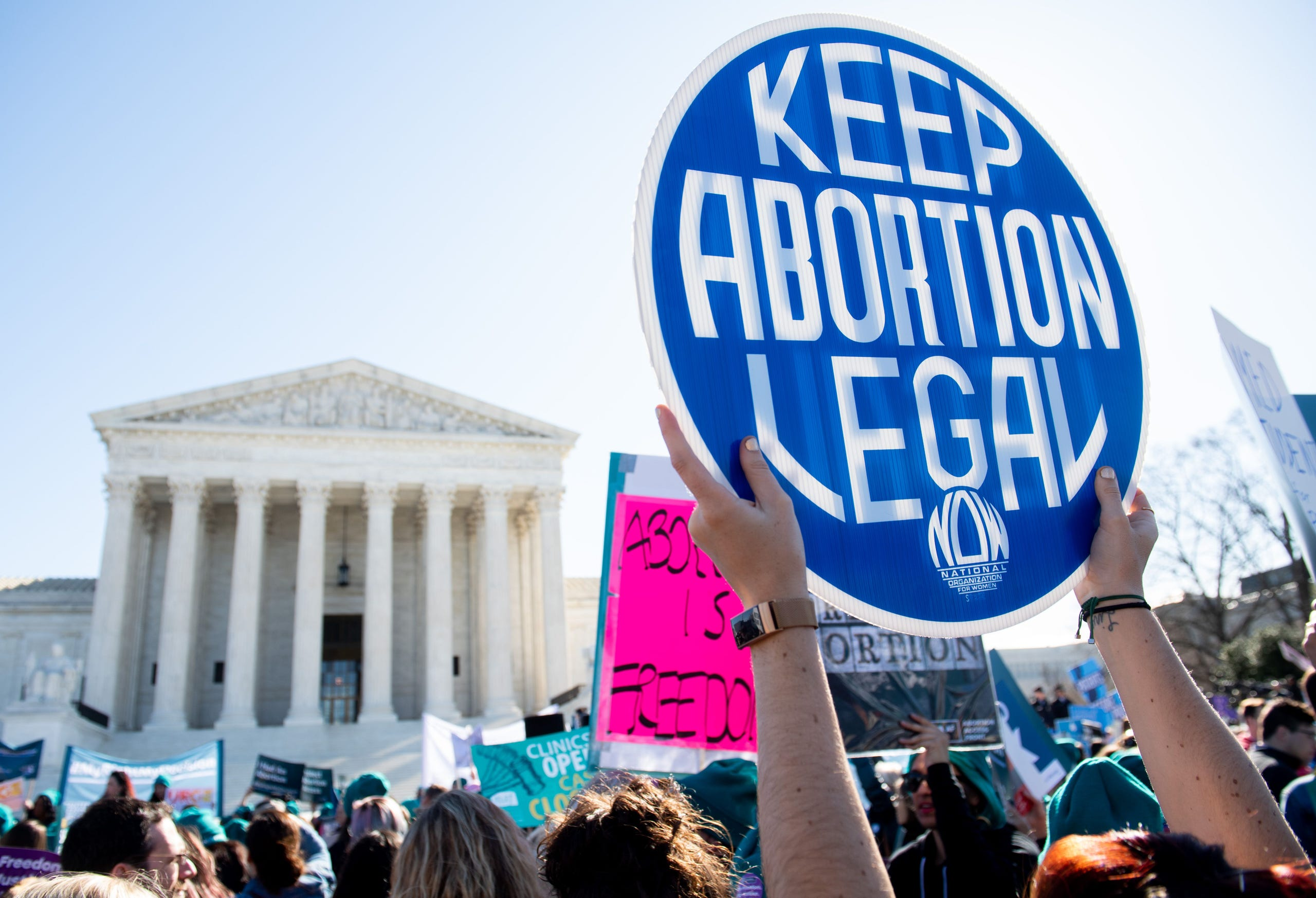 (FILES) In this file photo taken on March 04, 2020 pro-choice activists supporting legal access to abortion protest during a demonstration outside the US Supreme Court in Washington, DC, as the Court hears oral arguments regarding a Louisiana law about abortion access in the first major abortion case in years. - A US federal appeals court on March 31, 2020 ruled that Texas could temporarily suspend abortions as part of its response to the coronavirus crisis, overturning a ruling by a lower court the day before.  The governor of the conservative-leaning Lone Star State, Greg Abbott, had decreed that elective procedures should be delayed to ensure readiness to treat virus patients -- and to conserve protective gear for frontline workers. (Photo by SAUL LOEB / AFP) (Photo by SAUL LOEB/AFP via Getty Images) ORIG FILE ID: AFP_1QB28H