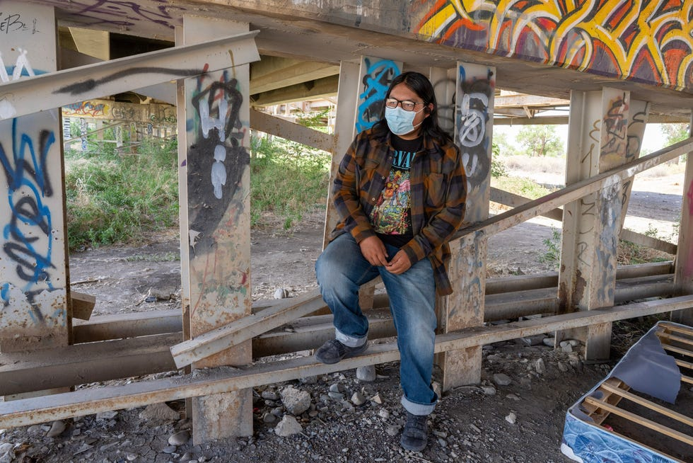 Evan Allen, pictured beneath the U.S. Highway 64 bridge in Shiprock, New Mexico, attended school last year while sitting in a truck on a remote hill — the only place he could get a decent internet connection.