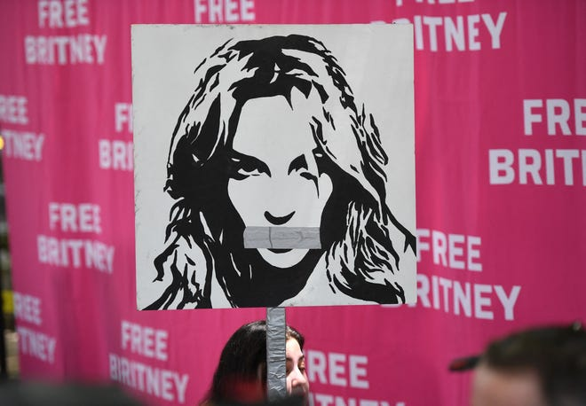 Poster of Britney Spears with her mouth taped shut outside the Los Angeles County Courthouse on July 14, 2021.