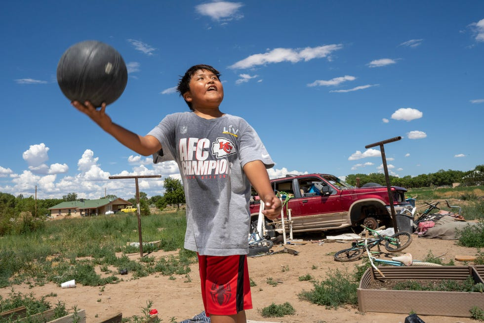 Carter Mariano shoots hoops at his family's home in Shiprock, New Mexico.