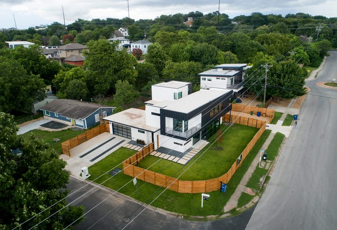 Two new houses were built on a single lot at Barton Skyway and Locke Lane in South Austin.  City leaders could consider making changes to Austin's land development code in the coming months as the city continues to grapple with soaring home prices.