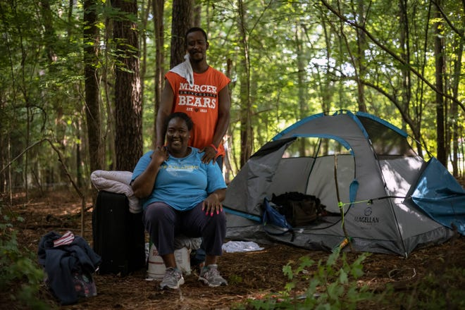 Cheryl Gamble and Clint Marable live in a tent in the woods off Jefferson Road. The couple have been without permanent housing on and off for the past several years, but are looking forward to the possibility of having a more stable living situation through a government-funded facility.