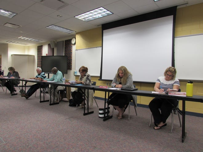The Twinsburg Board of Education and the district administration heard comments from parents regarding the planned masking policy. Pictured from left are Superintendent Kathryn Powers, and Board members Rob Felber, Mark Curtis, Tina Davis, Adrienne Gordon and Angela DeFabio.
