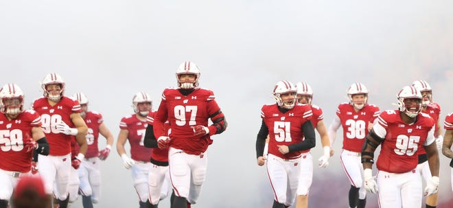 Wisconsin players take the field at Camp Randall Stadium ahead of last year's game against Minnesota on Dec. 19. The Badgers haven't had a losing season in 20 years but are coming off a 4-3 season that was severely affected by the pandemic.