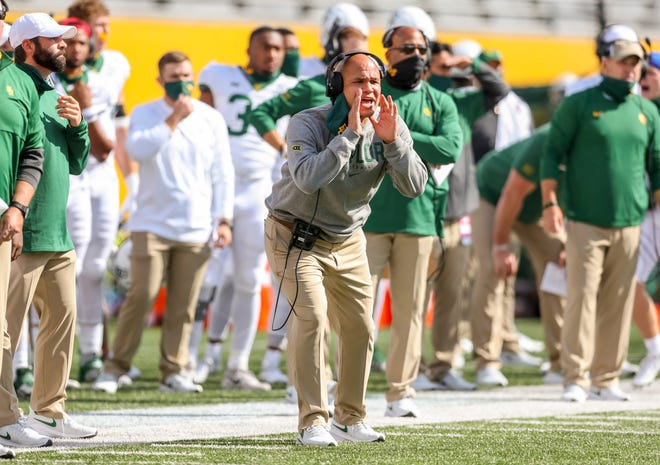 Baylor coach Dave Aranda yells to his team from the sideline during last year's game at West Virginia. The Bears' coach has a big decision to make: Who will replace Charlie Brewer, who has transferred to Utah, as the starting quarterback?