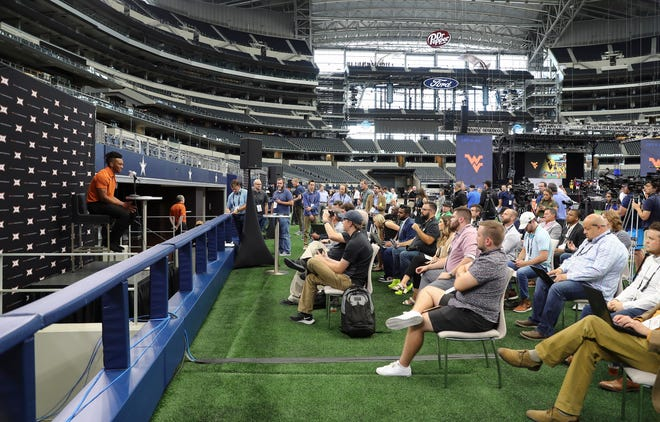 Texas running back Bijan Robinson, speaking Thursday at Big 12 media days in Arlington, is already taking advantage of the new NIL laws, like many other high-profile college athletes.