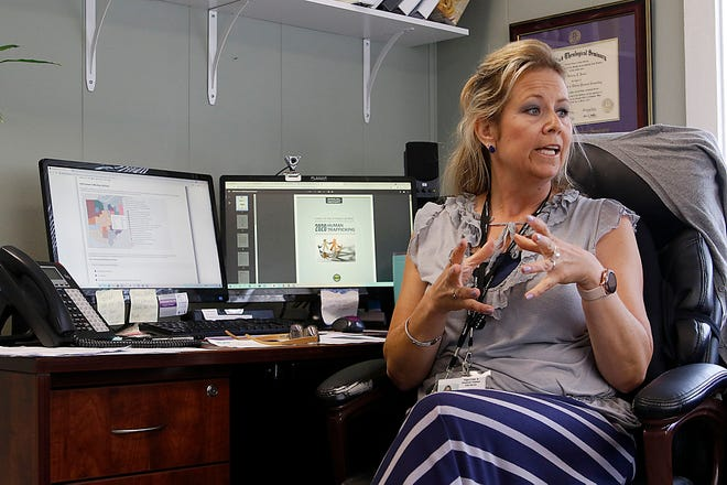 Safe Haven's Rebecca Jentes talks about human trafficking in her office on Tuesday, July 6, 2021. TOM E. PUSKAR/TIMES-GAZETTE.COM