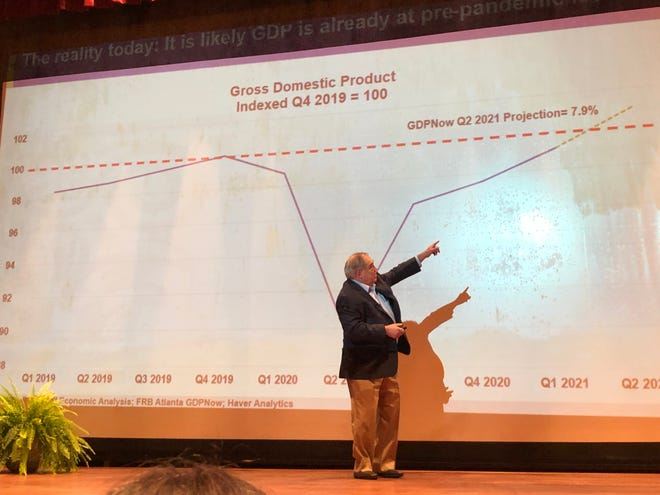 Dr. David E. Altig, executive vice-president and director of research at the Federal Reserve Bank of Atlanta, points to a model projection showing the U.S. gross domestic product exceeding Fed forecasters' expectations, during a keynote speech Wednesday at Augusta Technical College.