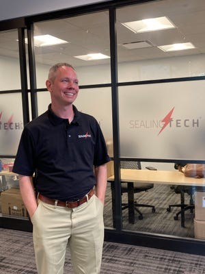 Ed Sealing, CEO of Sealing Technologies, outside the company's new office in the Georgia Cyber Center in Augusta.