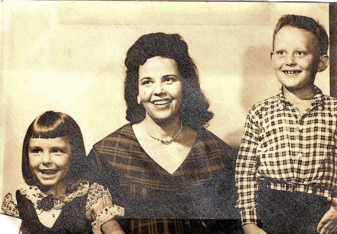 Betty Neumar (center) is shown with son Gary Flynn and daughter Peggy Flynn in an undated photo. All five of Neumar's husbands died, and she was on trial on murder solicitation charges when she died.