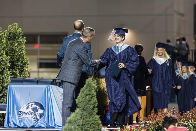 Evan Lino receiving his diploma at Bartlesville graduation.