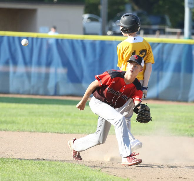 Prairie Home shortstop Layne Brandes takes a throw from the catcher while KWRT's Josh Barber goes into second base standing up during a recent Junior Babe Ruth game at Twillman Field in Harley Park. KWRT and played twice in the last week with KWRT winning both games 7-0 and 12-0.