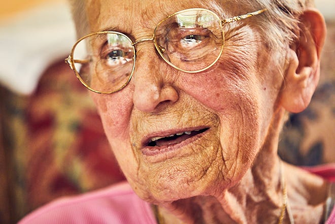 """Elvira """"Vera"""" Dupree reflects on her long life in her living room at Laurentide Assisted Living in Mashpee. She shares an Aug. 1 100th birthday this year with Virginia """"Ginny"""" Macdonald, who lives down the hall."""