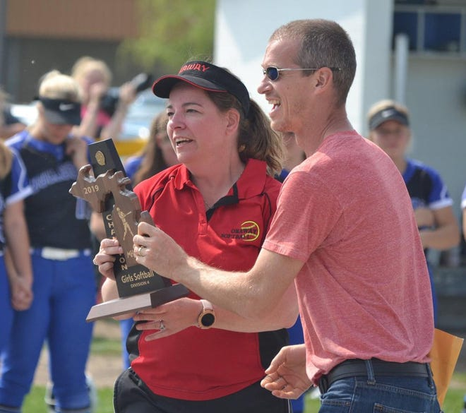 Onaway High Schoo athletic director Marty Mix, right, presents a Division 4 district softball championship trophy to Onaway head coach Jodi Brewbaker following Onaway's victory over Inland Lakes in 2019. Mix has had a successful tenure has Onaway's AD since taking over several years ago.