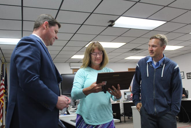 Cheboygan County Housekeeper Becky Velfling (center) was presented with a certificate of appreciation for her eight and a half years of service to the county by Cheboygan County Adminstrator Jeff Lawson (left) and Cheboygan County Maintenance Supervisor Darien Hughey (right.)