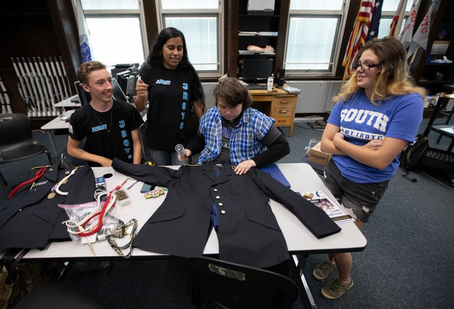 South High School JROTC cadets, from left, Joel Moren, Elizabeth Portalatin, Miranda Parsley and Abby Hutton put together Parsley's uniform as they prepare for the JROTC Leadership & Academic Bowl in Washington, D.C., which begins Tuesday.