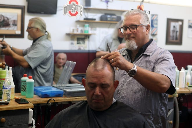 Westerville Barber Shop owner Tom Henry gives Mike Wander of Westerville a haircut July 10 at the shop, which turns 61 years old in August. Henry has owned the shop, at 599 S. State St., Suite C, since 2011.