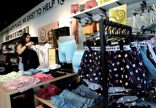 Mary Bentine, left, and Delani Dorsey prepare during the opening of the only standalone Gilly Hicks store on Thursday at Easton. The brand is an underwear, activewear and loungewear line by Columbus-based Abercrombie & Fitch.