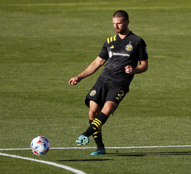 Columbus Crew SC midfielder Perry Kitchen (2) makes a pass against Philadelphia Union during the first half of their MLS game at Historic Crew Stadium in Columbus, Ohio on April 18, 2021.