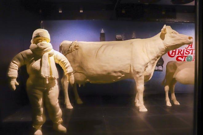 """A normal-sized butter cow, shown with a character from the movie """"A Christmas Story,"""" on display at a past Ohio State Fair. A contest will begin Monday encouraging people to build their own, much smaller, butter cow in the absence of a traditional Ohio State Fair this year."""