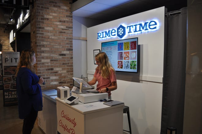 Julia Halterman of Plain City places an order July 15 on her first visit to Rime Time Curiously Crafted Pops with employee Allison Thornbloom. Halterman, who works in Dublin, said she had lunch at Dublin's North Market Bridge Park and tried Rime Time on the recommendation of a friend. Rime Time is the first vendor in a new rotating-business program called marketSHARE at North Market Bridge Park.