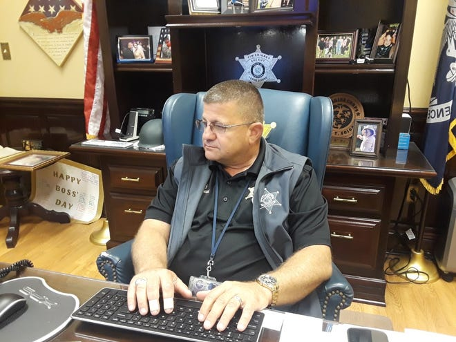 Terrebonne Sheriff Tim Soignet works at his desk Tuesday.