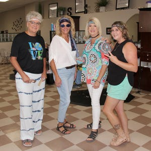 The staff at Shear Sisters on Second Street are dressed in their 1970s best, in conjunction with the Crazy Days theme, 'Crookston Vibes.' Left to right are Te Durbin, Tiffany Fee, Debbie Altepeter and Kari Trudeau.
