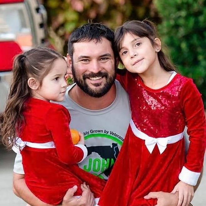 Afghanistan vet Sebastien LaJeunesse, shown pictured with his daughters at St. John Hops in Umatilla made the business of agriculture his pursuit after his Marine Corps service.