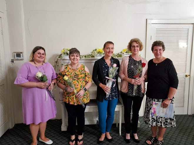 Sherry Wilkins, right, recently installed new officers for the Guernsey-Noble Business & Professional Women Club. They include, from left, Chandra Ontko, treasurer; Rhonda Stemmer, secretary; Jenny Stiers, vice president; and Bonny Mitchell, president. The local chapter was chartered in 1989 with the purpose of women helping women. Members have supported the Haven of Hope, scholarships, rape victims, breast cancer awareness month and Red Dress Affair. Those interested in joining can contact Stiers at jstiers@bi-coneng.com or Mitchell at mitch12056@yahoo.com.