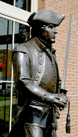 The bronze statue of General Wooster stands guard outside the main branch of the Wayne County Library in downtown Wooster.