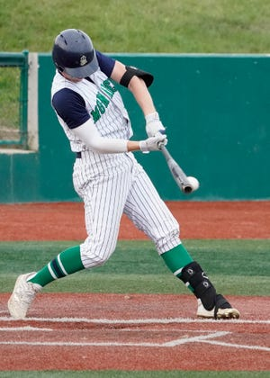 Michigan Monarchs' Cade Sullivan gets a hit during Wednesday's game against the Royal Oak Leprechauns.