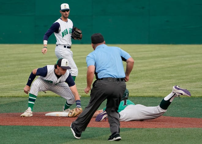 Michigan Monarchs second baseman Gavin Doyle (Western Michigan) tags out Royal Oak Leprechauns baserunner Noah Stout (Clemson) attempting to steal second base during Wednesday night's game at Siena Heights University.