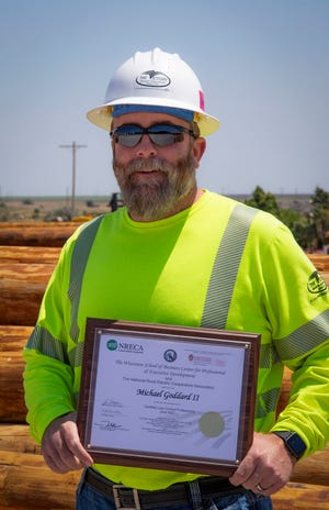 Mikey Goddard, Victory Electric's vice president of safety, with his new certificate.