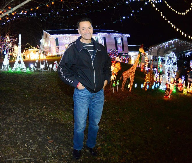 Emmett Santillo at his annual holiday lights display outside his North Sewickley Township home.