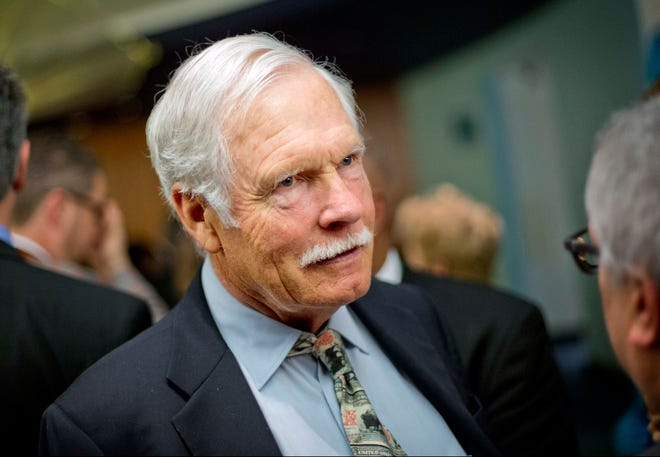 In this Dec. 6, 2013, file photo, Ted Turner talks with guests at the Captain Planet Foundation benefit gala in Atlanta.