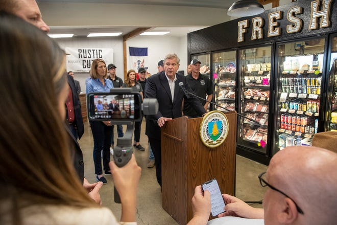 U.S. Secretary of Agriculture Tom Vilsack, at podium, speaks alongside Rep. Cindy Axne, D-3rd,  left, inside Rustic Cuts Friday, July 9, 2021 in Council Bluffs, Iowa. U.S. Agriculture Secretary Tom Vilsack announced his plan to spend $500 million to encourage the construction of smaller meat processing plants located closer to farmers who raise chickens, pigs and cows with the goal of diversifying an industry now consolidated among a few large processors.