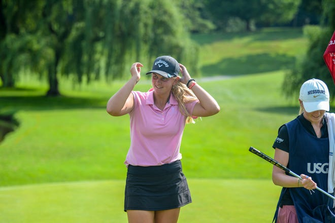 Kaitlyn Schroeder smiles after beating Kary Hollenbaugh 3 and 2 on Thursday in the 2021 U.S. Girls' Junior at Columbia Country Club in Chevy Chase, Md. With her is caddie Emily Staples.
