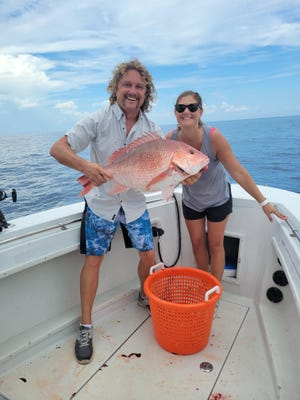 Fishing a live pogie on the surface somewhere between the Mayport Jetties and Bermuda, Brittany Putnam hooked and landed this slob red snapper, which outweighed the largest fish caught by her soon-to-husband, Michael Binder.