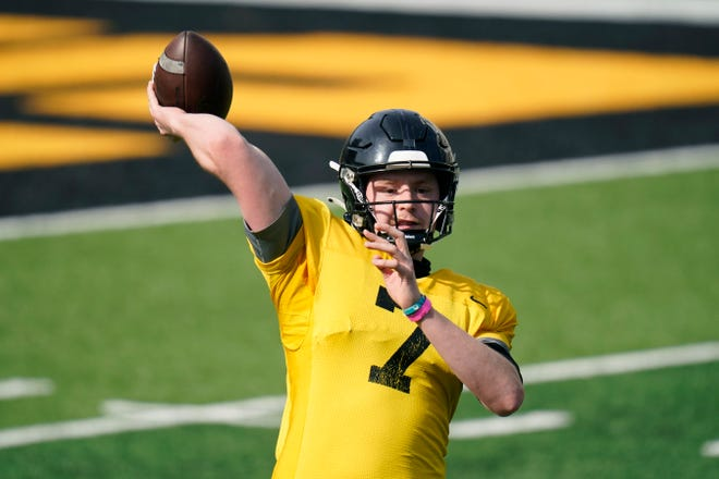 Iowa quarterback Spencer Petras (7) throws a pass during a practice on Saturday, April 17, 2021, in Iowa City, Iowa.